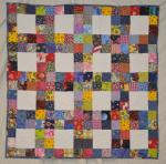 A Scrappy Baby Quilt Tutorial from Michelle's Romantic Tangle