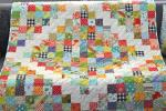 Potluck Scrap Quilt by Sarah Haslip from Orange You Glad